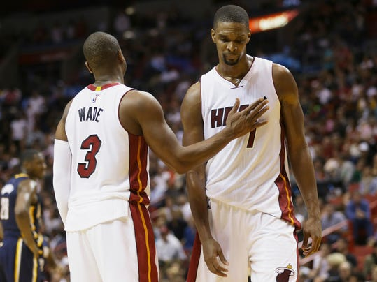 In this Monday, Jan. 4, 2016, photo, Miami Heat's Dwyane Wade (3) pats Chris Bosh (1) on the chest during the second half of an NBA basketball game against the Indiana Pacers in Miami. A person with knowledge of the situation said Monday, Feb. 15, Bosh is dealing with another blood-clot scare and will meet with multiple doctors this week with hopes of finding a way to continue playing this season. (AP Photo/Lynne Sladky)