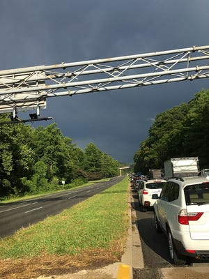 Traffic sits on U.S. 74-A eastbound after downed trees and utility lines caused an hourslong backup. The route was closed in both directions.