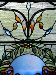 """Stained glass windows (or """"lights,"""" as they are called in old blueprints) are found in several homes in and around the Washington Park Historic District of North Plainfield. Windows such as these are the focus of """"The Lights of Washington Park,"""" published late last year by Ken Lombardo of Piscataway. The coffe-table book features about 600 photographs taken by Lombardo."""