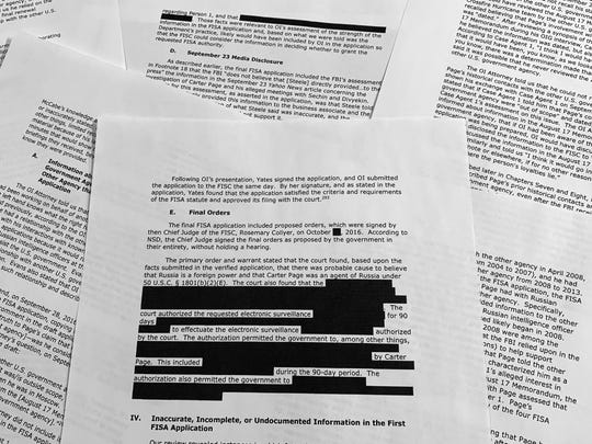 Pages from the report issued by the Department of Justice inspector general is photographed in Washington, Monday, Dec. 9, 2019. The report on the origins of the Russia probe found no evidence of political bias, despite performance failures. (AP Photo/Jon Elswick)