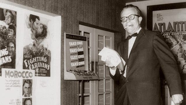 Marlow Theater manager Gene Brown on the day of the premiere of The Naked Edge. Note the Gary Cooper movie posters at left.