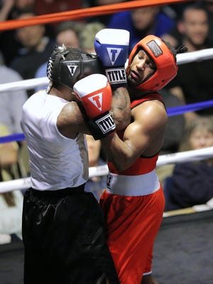 Boxer Frank Martin delivers an upper cut to the face of opponent Javar Jones in the Open 141 pound fight during the Indiana Golden Gloves held in Indianapolis on April 16, 2015.