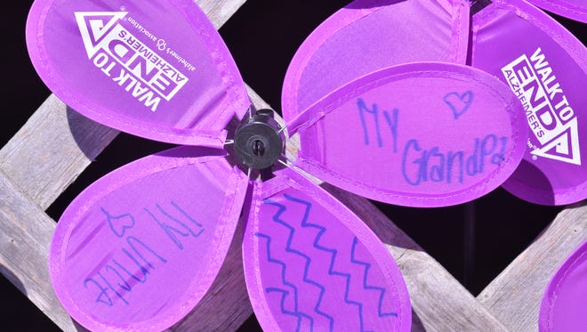 Windmill flowers are displayed round the deck at Auburn University Montgomery the 'Montgomery Walk to End Alzheimer's', hosted by the Alabama/Florida panhandle chapter of the Alzheimer's Association, at Auburn University Montgomery on Saturday, Nov. 1, 2014.