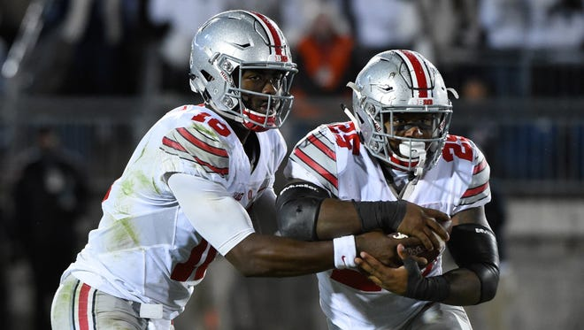 Can J.T. Barrett (left) and Mike Weber get the Ohio State offense going and sustain the Buckeye's College Football Playoff hopes?
