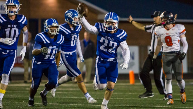 Dixie linebacker Jake Staheli (22) celebrates after intercepting a pass last year. Staheli has been the anchor this season  for a stout Dixie Flyers defense that has allowed just 11 points per game during their four-game win streak.