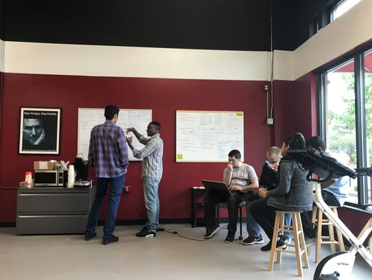 Students collaborate at Great North Lab, a technology