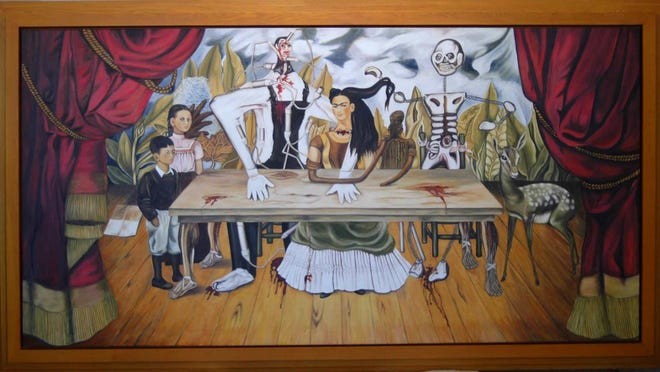 """This Feb 2010 photo provided by the Kunstmuseum Gehrke-Remund shows a licensed replica of the missing, original painting by Mexican artist Frida Kahlo, titled """"La Mesa Herida"""" in an unknown location. The whereabouts of the original 1940 painting, which disappeared more than six decades ago in Poland, will remain one of the great mysteries of contemporary art. Historians and scholars of the Mexican artist strongly reject the claim that the original is in a London warehouse, waiting for a buyer to spend more than 40 million euros on it."""