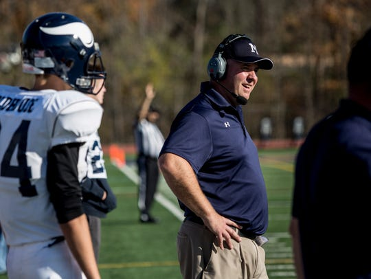 Marysville coach Mark Caza watches from the sidelines