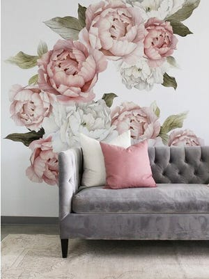 Design your own mural with decals to personalize apartment walls that can't be painted.