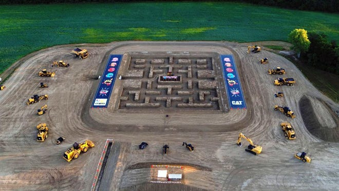 Caterpillar Inc. constructed a life-sized Pac-Man game board at its Edwards Demonstration & Learning Center. The board was used in a Caterpillar promotional video that featured the iconic 1980s video game.