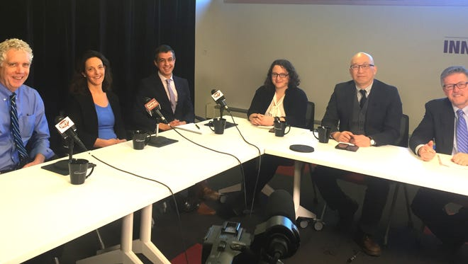 Panelists discuss marijuana legalization and regulation during an episode of The Table Thursday at Free Press Media.