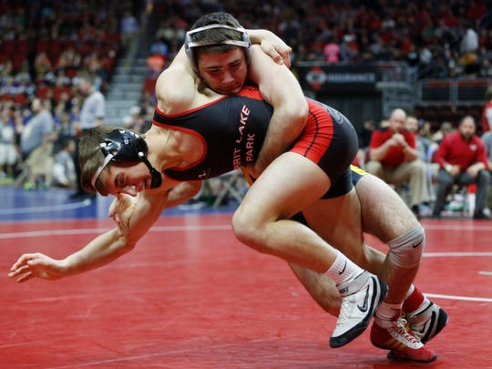 Clear Lake's Ryan Leisure (top) brings down Spirit Lake Park's Kyler Reick in their 145-pound match Friday, Feb. 17, 2017 during the class 2A quarterfinals at the 2017 State Wresting Tournament at Wells Fargo Arena in Des Moines.