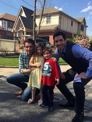 """Property Brothers"" Jonathan and Drew Scott with Ava and Max Hagerty in Eastchester. The Hagerty dream home is in the background."