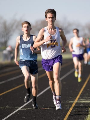 Unioto's Tucker Markko, middle, powers through the 1600 field for his second straight county title.