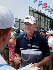 Steve Stricker signs autographs for fans during the