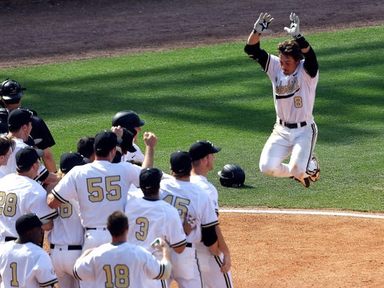 Vanderbilt's Rhett Wiseman (8) celebrates as he approaches home plate after hitting a walk-off home run during the 10th inning at the 2015 SEC Tournament in Hoover, Ala.