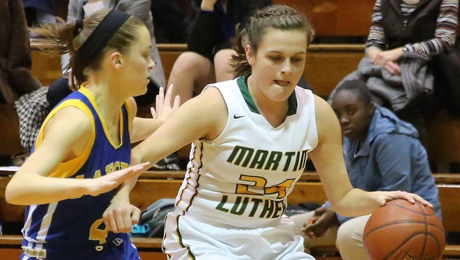 Martin Luther's Emily Hafemann drives around a defender during a game against St. Joseph's.