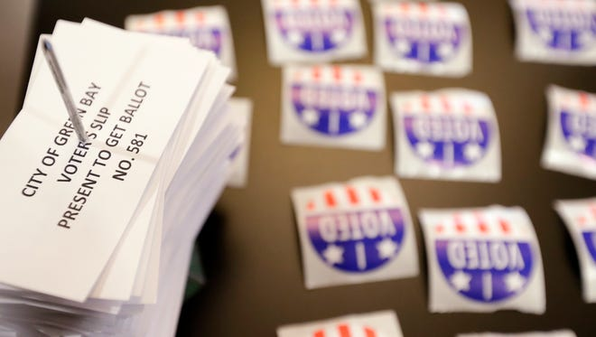 Used voter slips are stacked on a table at a polling site at the Green Bay Botanical Garden on Nov. 8 in Green Bay.