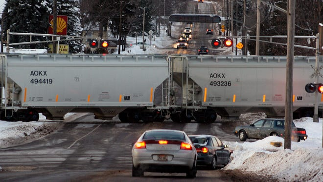 A Union Pacific train blocks traffic on Main Street in Chippewa Falls in February. Some area residents have become frustrated by hours-long road blockages caused by halted frac-sand trains.