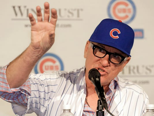 FILE - In this Nov. 3, 2014, file photo, Joe Maddon is introduced as the new manager of the Chicago Cubs baseball team in Chicago. It's a brand new day for the Cubs when they report to Arizona after a banner offseason that included the addition of Maddon, who had a 754-705 record during his successful nine-year run with Tampa Bay. (AP Photo/M. Spencer Green, File)