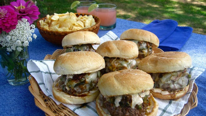 Chilies, onions and cheese top these beer-steamed burgers made from ground chuck.
