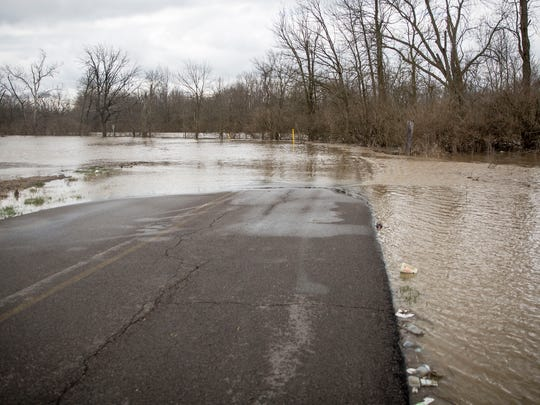 Sections of South Butterfield Road have become impassible on April 4 after heavy rains flooded nearby fields and caused the White River to enter flood stage. The river reached moderate flood stage this afternoon at 12 feet, the highest it's been since 2013.
