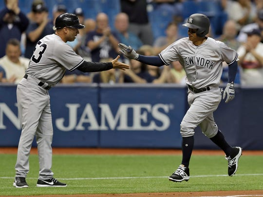 Yankees' Ronald Torreyes, right, shaking hands with