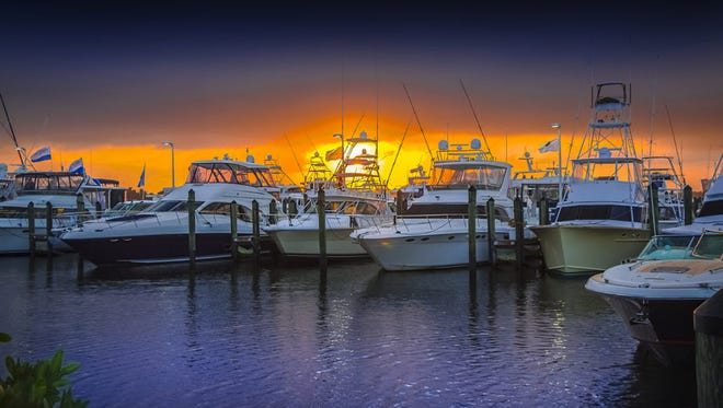 Boats in the Stuart Boat Show are docked at Allied Richard Bertram Marina in Stuart at sunset. The 38th annual show takes place Jan. 13-15, 2017.