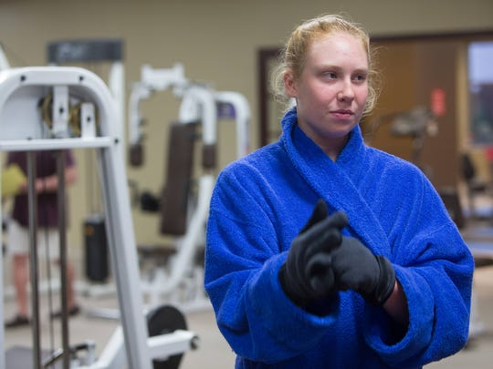 Tara Carr, 18, a senior at Conrad School of Science gets ready to enter the cryotherapy chamber at First State Health and Wellness.