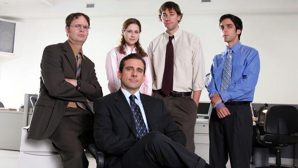 Rainn Wilson, left, Steve Carell, Jenna Fischer, John
