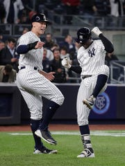 New York Yankees' Didi Gregorius, right, celebrates