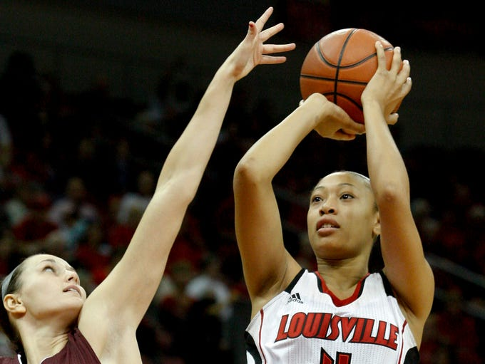 U of L's Antonita Slaughter, #4, shoots over Missouri State's Kenzie Williams, #4, during their game at the KFC Yum! Center.  She was later  removed by a stretcher after she collapsed from an apparent seizure. Dec. 3, 2013