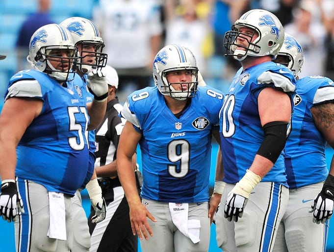 Lions quarterback Matthew Stafford is helped back on his feet after getting sacked, for the fourth time in the game, late in the fourth quarter as Detroit fell to the Carolina Panthers, 24-7, at Bank of America Stadium in Charlotte, North Carolina on Sunday, Sept. 14, 2014.