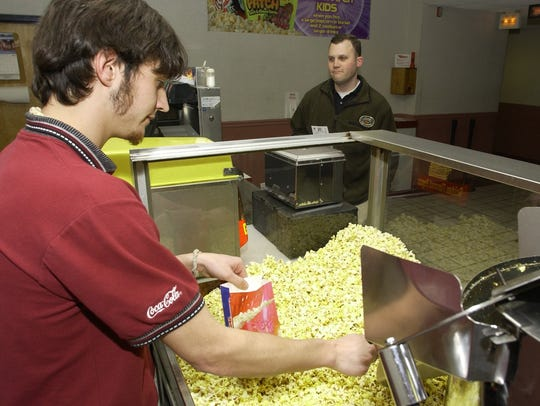 Aaron Ryman, serves up a popcorn to Brent Graden at