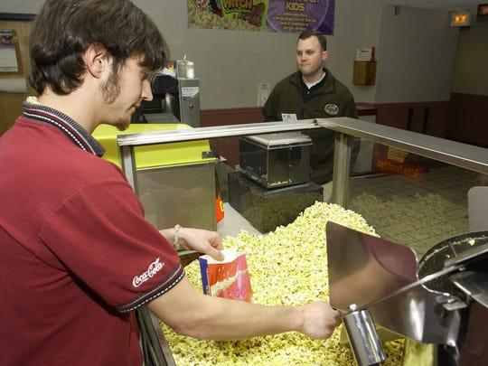 Aaron Ryman, serves up a popcorn to Brent Graden at