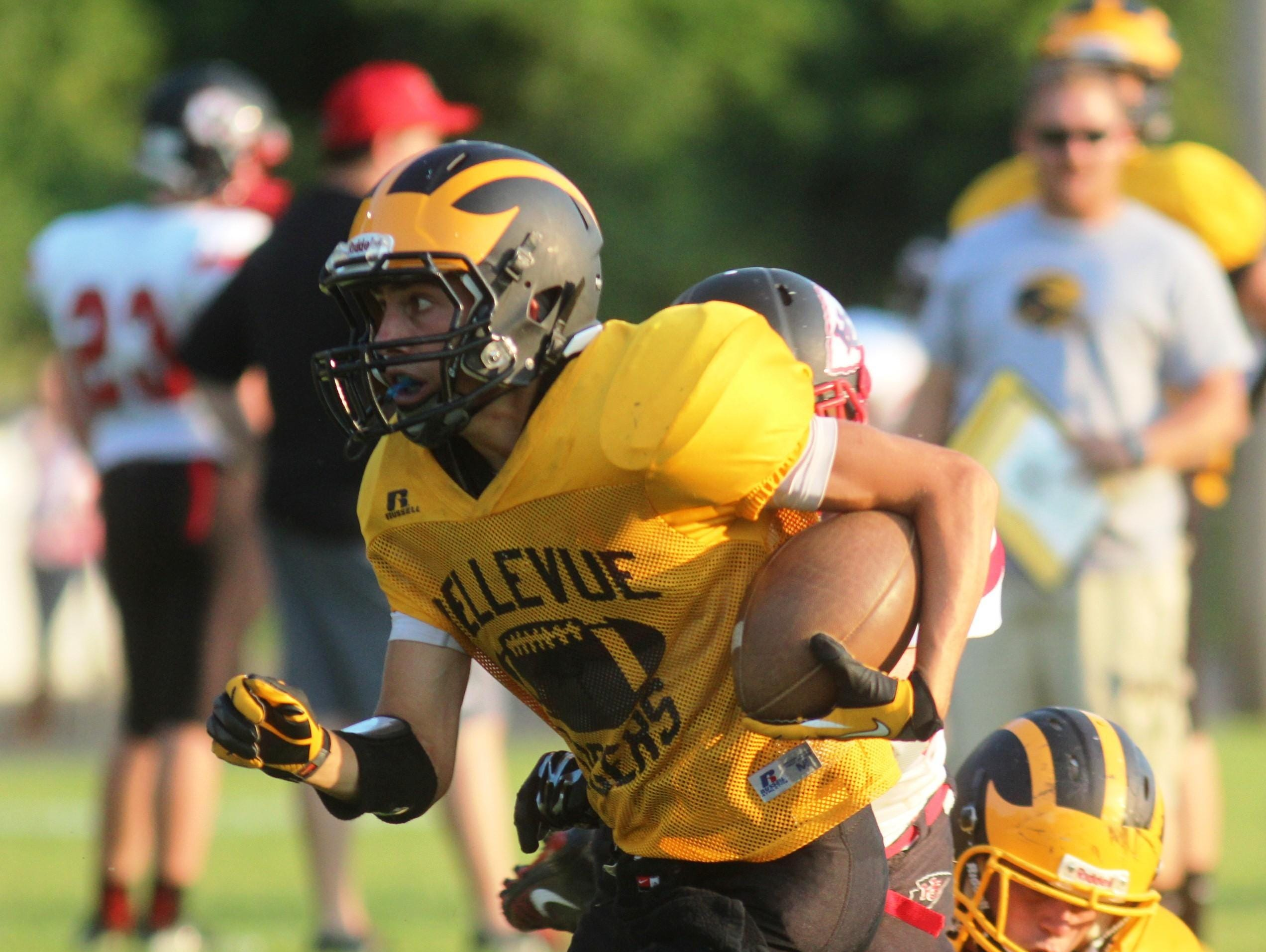 Bellevue's Nick Ackerson makes a nice gain during a scrimmage against Holy Cross.