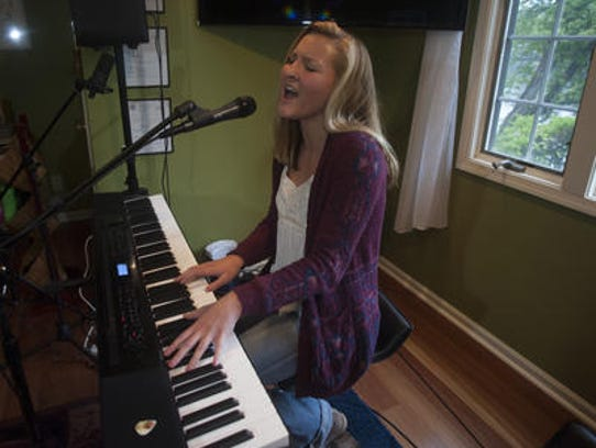 CC Miles of Medford Lakes plays the electric keyboard