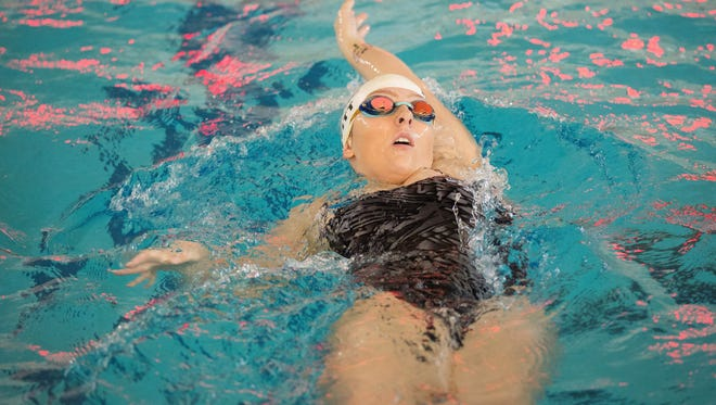 Piedra Vista's Sheala Moffitt swims the backstroke portion of the 200-yard individual medley on Saturday at the Farmington Aquatic Center.