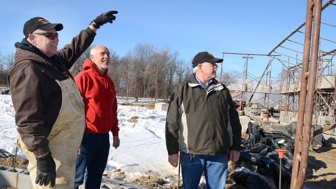 Walt Holden, left, who is serving as general contractor during the rebuilding of Holden's Party Store and Deli, talks with brothers Bruce Holden and Pete Holden, who partner in ownership and management of the store.