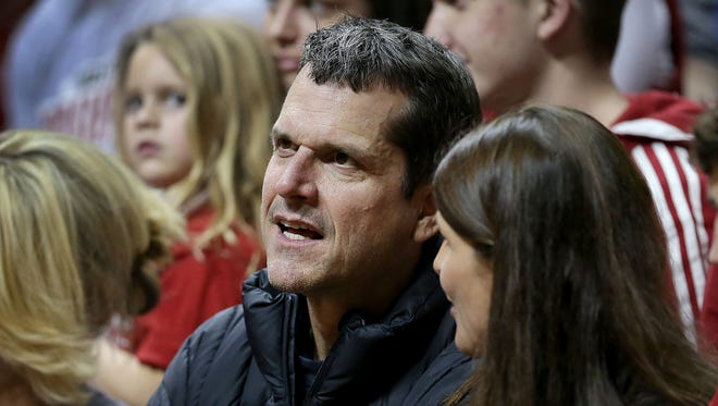 Michigan football football Jim Harbaugh talks with his sister Joani Harbaugh Crean, right, in the second half of a basketball game between Eastern Illinois and Indiana at Assembly Hall.