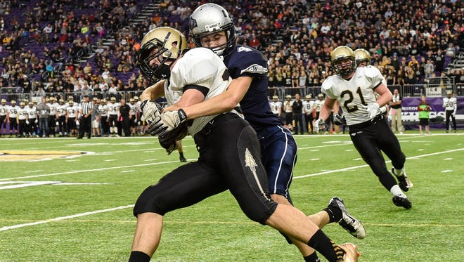 Eden Valley-Watkins' Greg Lux tackles Caledonia's Ben McCabe on a run along the sideline during the first half Friday, Nov. 25, at the U.S. Bank Stadium in Minneapolis.
