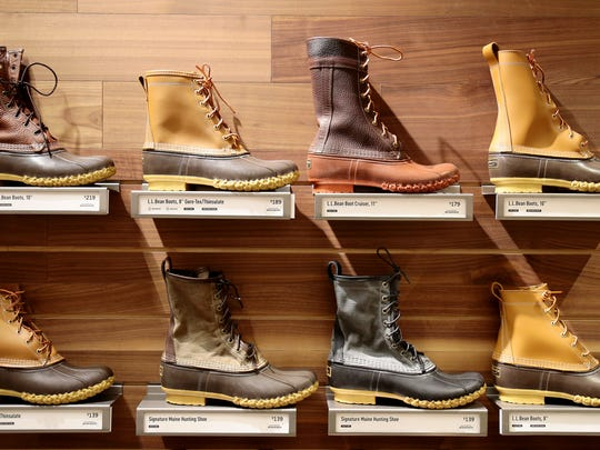 A selection of L.L. Bean's signature Bean Boots at the new L.L. Bean location in Kenwood, Ohio, on Thursday, Nov. 3, 2016. Bean Boots were recently on a long back order as production struggled to meet demand. All Bean Boots are hand made in Maine.