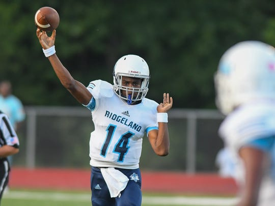 Ridgeland High School quarterback Zy McDonald (14) throws a pass against Velma Jackson during game action Thursday in Camden.