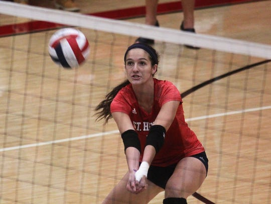 St. Henry's Maria Tobergte digs a shot during St. Henry's 3-2 win over Notre Dame in the Ninth Region volleyball championship Oct. 26, 2017, at Holmes.