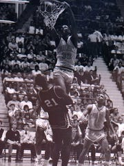 Billy Owens goes up for an uncontested dunk against a Meadville defender in the 1987 PIAA Class 4A championship at Hersheypark Arena.