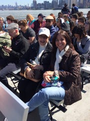 On April 30, Dotty Epstein of Metuchen and members of her immediate family, Cathy, Steve, Brian and Kyle Thompson of Montgomery and Shaun Epstein of New York headed to Ellis Island to mark the 100th anniversary of their ancestors' arrival in America. Dotty Epstein and her daughter Cathy Thompson relax on the boat ride from Liberty State Park to Ellis Island.