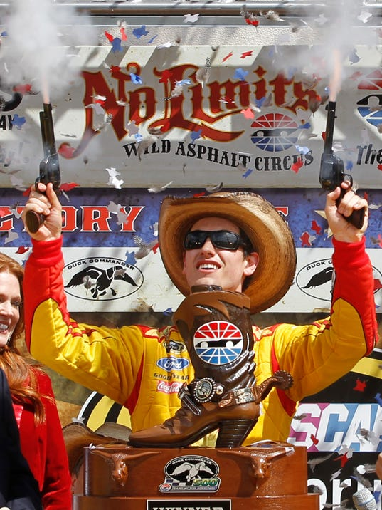 FILE - In this April 7, 2014, file photo, Joey Logano shoots off pistols celebrating winning the NASCAR Sprint Cup Series auto race at Texas Motor Speedway in Fort Worth, Texas. It's the wild west in NASCAR right now, and it's not clear if that's good or bad for this championship battle. Drivers are doing whatever they have to do to make it to the finale, to mixed reactions. (AP Photo/Mike Stone, File)