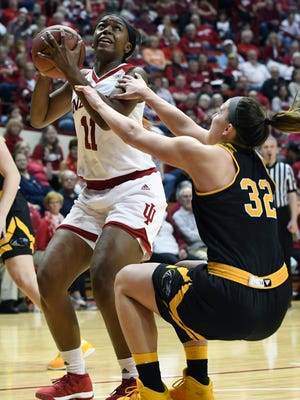 Indiana Hoosiers forward Kym Royster (11) is called for an offensive foul as she goes up for a layup against Milwaukee at Simon Skjodt Assembly Hall in Bloomington, Ind., on Sunday, March 18, 2018.