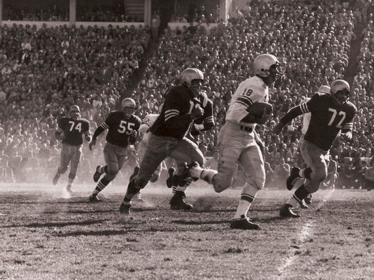 Lions quarterback Tobin Rote runs the ball in the playoff game against the 49ers on Dec. 22, 1957 at Kezar Stadium in San Francisco. The Lions rallied from a 27-7 deficit in the third quarter for a 31-27 win to advance to the NFL title game.