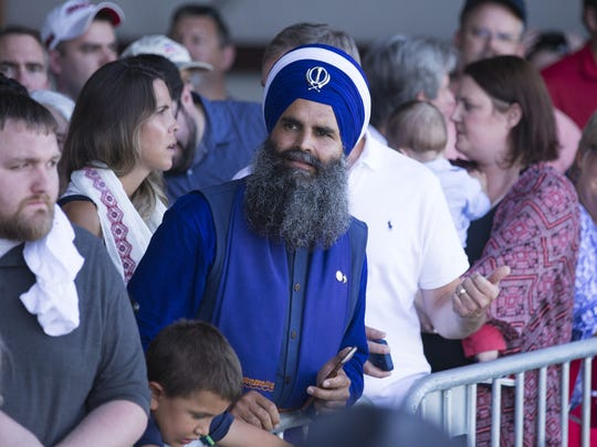 A photo of Gurinder Singh Khalsa, shown here attending a rally for Indiana Gov. Mike Pence in Zionsville, has been used on a pro-Trump campaign poster, which identified him as a Muslim. The practicing Sikh says he is not a Trump supporter.